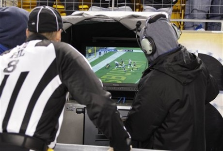 An official watches a replay of a Pittsburgh Steelers safety in the fourth quarter of an NFL football game against the New England Patriots in Pittsburgh, Sunday, Oct. 30, 2011. The Steelers appealed the call on the field believing the safety was a touchdown. After review, the ruling on the field stood. The Steelers won 25-17. (AP Photo/Gene J. Puskar)